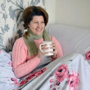 Women in bed resting